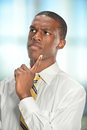 Portrait of businessman thinking african american over white background Stock Photography