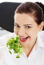 Portrait of a businesswoman eating lettuce Royalty Free Stock Photo