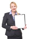 Portrait of a businesswoman showing empty sign clipboard Royalty Free Stock Photo