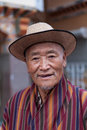 Portrait of a buthanese man wearing traditional dress thimphu bhutan september on september in thimphu bhutan although tourism is Stock Images