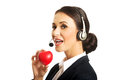 Portrait of call center woman holding heart model Royalty Free Stock Photo