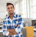 Portrait of casual man at office smiling looking camera Royalty Free Stock Photography