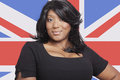 Portrait of casual mixed race woman against british flag Royalty Free Stock Photo