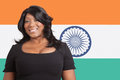 Portrait of casual mixed race woman over indian flag Royalty Free Stock Images