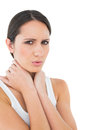 Portrait of a casual woman suffering from neck ache closeup young over white background Stock Photography