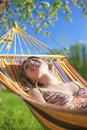 Portrait of Caucasian Blond Lady Resting in Hummock During Spring Time Royalty Free Stock Photo