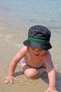 Portrait of caucasian happy baby boy in sea with hat stock photo Royalty Free Stock Photo