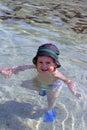 Portrait of caucasian happy baby boy in sea with hat stock photo Stock Photo