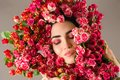 Portrait charming woman makeup face with red roses flower Royalty Free Stock Photo