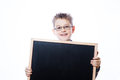 Portrait of cheerful boy pointing to banner on the white background Royalty Free Stock Photos