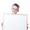 Portrait of cheerful boy pointing to banner on the white background Stock Photography