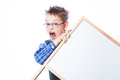 Portrait of cheerful boy pointing to banner on the white background Royalty Free Stock Image