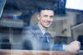 Portrait of a cheerful businessman in cafe Royalty Free Stock Photo