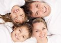 Portrait cheerful family having fun together lying bed home top view Stock Images