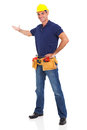 Portrait cheerful handyman presenting over white background Royalty Free Stock Images