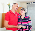 Portrait of cheerful mature couple in home interior Stock Image