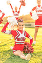 Portrait of a cheerleader in action happy cheerleaders Royalty Free Stock Photo