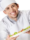Portrait of chef cook offering salad dish isolated on white Royalty Free Stock Images