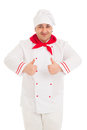 Portrait of chef showing thumb up sign with both hands wearing rend and white uniform in the studio over white background Royalty Free Stock Photos