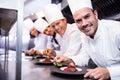 Portrait Of Chefs Team Finishi...