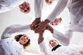 Portrait of chefs team putting hands together and cheering Royalty Free Stock Photo