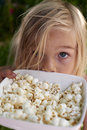 Portrait of Child Blond Girl eating popcorn Royalty Free Stock Photo
