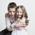Portrait of a child the love of brother and sister in his arms on a white background Royalty Free Stock Photos