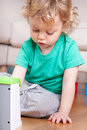 Portrait of child playing with toys Royalty Free Stock Photo