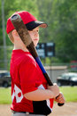 Portrait of child preparing to bat during baseball game organized league Stock Photos