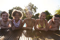 Portrait Of Children Having Fun In Outdoor Swimming Pool Royalty Free Stock Photo