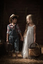 Portrait of children in a rustic barn boy and girl came for walk Royalty Free Stock Images