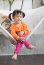 Portrait of children toothy smiling and relaxing in clothes crad cradle at home living terrace Royalty Free Stock Photo