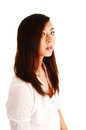 Portrait of chinese girl a shoot a young beautiful woman for white background in a white blouse and brunette hair Royalty Free Stock Photography