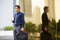 Portrait of chinese office worker with coffee cup businessman standing near building in panama and suitcase Stock Images