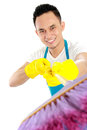 Portrait of cleaning service showing broom to camera Stock Photography