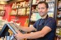 Portrait clerk stood by electronic cash register Royalty Free Stock Photo