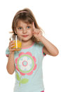 Portrait clever little girl glass orange juice white background Stock Photography