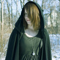 Portrait of a Cloaked Young Woman Royalty Free Stock Photo