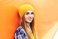 Portrait closeup beautiful young girl in yellow hat Royalty Free Stock Photo