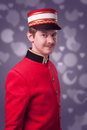 Portrait of a concierge porter in a red jacket Royalty Free Stock Image