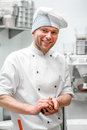 Portrait of confectioner handsome at the restaurant bakery kitchen Stock Images