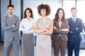 Portrait of confident business team in office standing with their hands crossed Stock Image