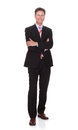 Portrait of confident businessman with arms crossed full length standing against white background Royalty Free Stock Image