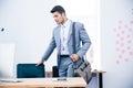 Portrait of a confident businessman with bag