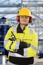 Portrait of a confident docker wearing all required personal protective equipment posing in front an industrial container Stock Images