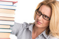 Portrait of confident female advocate looking at books teacher table with on white background Stock Photo