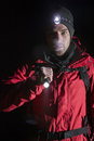 Portrait of confident male hiker with flashlight at night Royalty Free Stock Photo