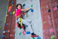 Portrait of confident teenage girl practicing rock climbing Royalty Free Stock Photo