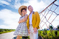 Portrait of confident woman standing with man on field against sky Royalty Free Stock Photo