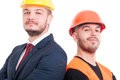 Portrait of confident workers standing back to back